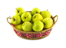 Ripe yellow apples in long brown wicker basket iso Royalty Free Stock Images