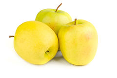Ripe yellow apples on a white background. Fresh ripe juicy yellow apples on a white background Stock Photo