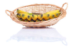 Ripe yellow bananas baby in a wicker basket isolated on white ba Stock Images
