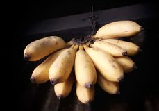 Ripe yellow bananas hanging inside a shop royalty free stock images