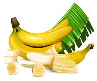 Ripe yellow bananas with slices and leaves. Royalty Free Stock Images