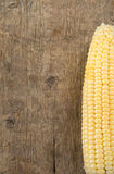 Ripe yellow corn on wood Stock Photo