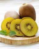 Ripe yellow kiwi Stock Photos