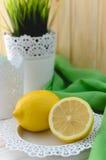 Ripe yellow lemon in a beautiful white plate Royalty Free Stock Photo