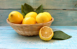 Ripe yellow lemons in a basket Royalty Free Stock Images