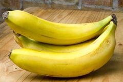 Ripe yellow organic bananas Stock Images