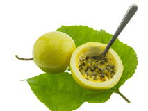 Ripe yellow passion fruits half cut isolated on white Royalty Free Stock Image