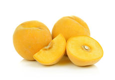 Ripe yellow peach on white background Stock Photography