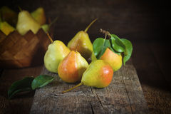 Ripe yellow pears lying on a wooden serface Royalty Free Stock Photo