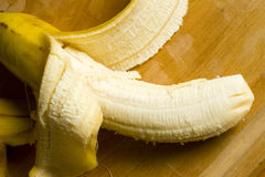 Ripe yellow peeled banana Royalty Free Stock Photos