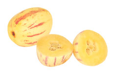 Ripe yellow pepino melon. Ripe pepino melons with one freshly cut to display the inside stock photography