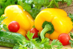Ripe yellow pepper and vegetables Stock Images
