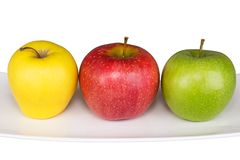 Ripe yellow, red, green apple  on white. Ripe yellow, red, green apple  on a white background with a sprig Stock Photo