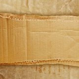 Riped grunge cardboard background Royalty Free Stock Photography