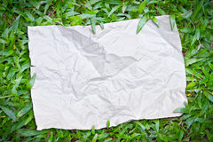 Riped paper on the grass Royalty Free Stock Images