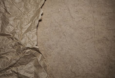 Riped vintage paper on cardboard background Royalty Free Stock Photos