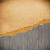 Riped vintage paper on grunge background Royalty Free Stock Photography
