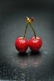 Ripen cherries against black background. Perfect ripen cherries against black background Stock Images