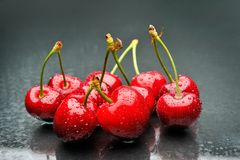 Ripen cherries against black background. Perfect ripen cherries against black background Royalty Free Stock Photography
