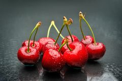 Ripen cherries against black background. Perfect ripen cherries against black background royalty free stock photo