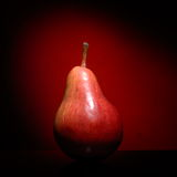 Ripen pear  on red background Stock Photo