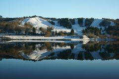 Ripley Ski Hill Reflected in the Portage Canal stock photo