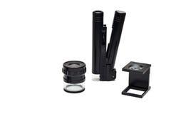 Riporti in scala le lenti di ingrandimento, la lente di ingrandimento, micro lente di ingrandimento Fotografia Stock Libera da Diritti