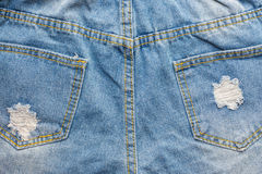 Ripped blue jeans. Close up back side of  ripped blue jeans Royalty Free Stock Photos