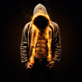 Ripped. Body builder with burning hoody Stock Image