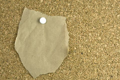 Free Ripped Brown Paper On Cork-board Stock Photography - 17950842