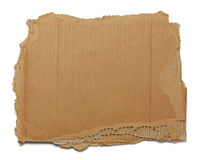 Ripped Cardboard. Brown corrugated cardboard torn and isolated on white royalty free stock image