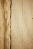Ripped cardboard. Ripped and wrinkled brown cardboard stock images