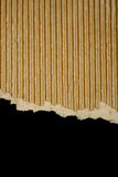 Ripped cardboard on black. Background royalty free stock photo