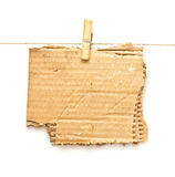 Ripped cardboard piece paper note on clothes rope Royalty Free Stock Images
