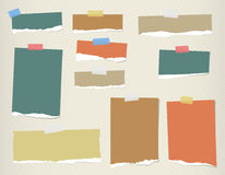 Ripped colorful blank note paper are stuck on lined pattern Royalty Free Stock Photography