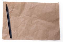 Ripped crumpled  pieces of packaging paper and japanese pen,  is Royalty Free Stock Photo