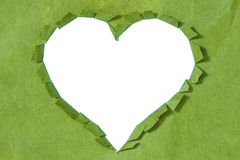 Ripped  heart in a green paper Royalty Free Stock Image