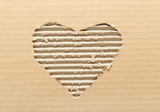 Ripped heart shaped cardboard Royalty Free Stock Images