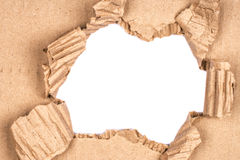 Ripped hole in cardboard Royalty Free Stock Images