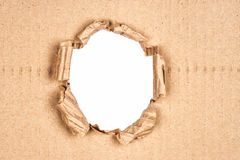 Ripped hole in cardboard Stock Photo