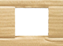 Ripped hole in cardboard Royalty Free Stock Image