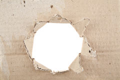 Ripped hole in cardboard Royalty Free Stock Photography