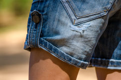 Ripped jean shorts. Casual wear royalty free stock photography