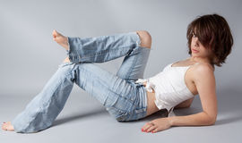 Ripped Jeans, Bare Feet Stock Images