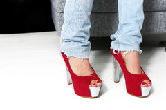 Ripped jeans and high heels Royalty Free Stock Photography
