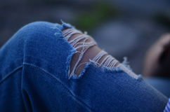 Ripped jeans stock image