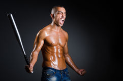 The ripped man with baseball bat Stock Photos