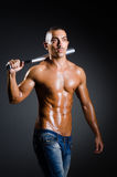 The ripped man with baseball bat Stock Images