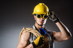 Ripped muscular builder man. With tools Stock Photo