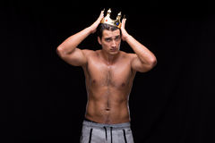 The ripped muscular man with king crown. Ripped muscular man with king crown Stock Photography